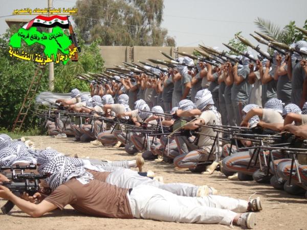 جيش النقشبندية قصف مقر للعدو الأمريكي بـ7 صواريخ الحق 19/3/2013 019